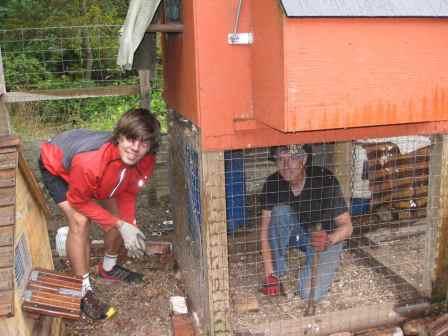 American WWOOFers Sean & Steve Securing Chicken Coop