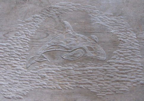 Orca Carving On The Bus Shelter Bench