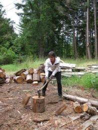 American WWOOFer Erika Chopping Wood