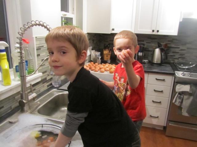 Leo & Seb washing eggs